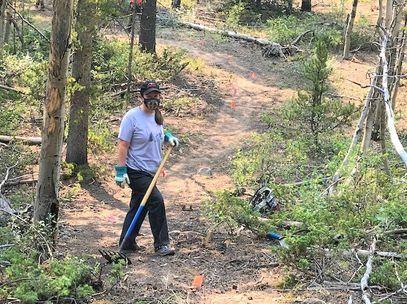 Volunteer working at Sacramento Creek Ranch